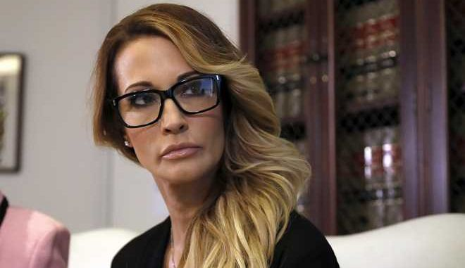"Jessica Drake listens to a question during a news conference at the office of her attorney, Gloria Allred, in Los Angeles on Saturday, Oct. 22, 2016. Drake, an adult film actress, said Donald Trump kissed her and two other women on the lips ""without asking for permission"" when they met him after a golf tournament in 2006. (AP Photo/Ryan Kang)"