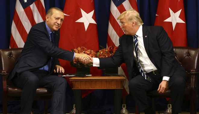 Turkey's President Recep Tayyip Erdogan, left, and US President Donald Trump shake hands prior to their meeting in New York, Thursday, Sept. 21, 2017. Erdogan is in New York for the United Nations General Assembly. (Pool Photo via AP)