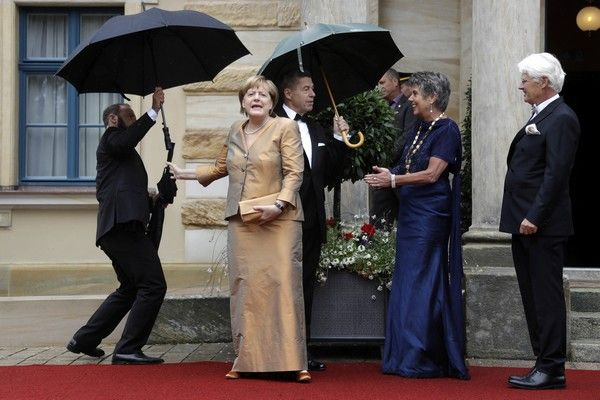 German chancellor Angela Merkel , left, and her husband Joachim Sauer, second left, arrive for the opening of the Bayreuth Opera Festival in Bayreuth, Germany, Tuesday, July 25, 2017. (AP Photo/Matthias Schrader)