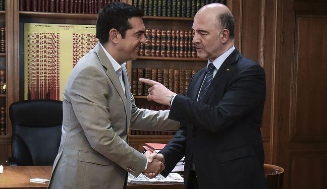 Συνάντηση του Πρωθυπουργού Αλέξη Τσίπρα με τον Επίτροπο Οικονομικών Υποθέσεων της Ευρωπαίκής Ένωσης Πιέρ Μοσκοβισί, την Τρίτη 3 Ιουλίου 2018. (EUROKINISSI/ΤΑΤΙΑΝΑ ΜΠΟΛΑΡΗ)