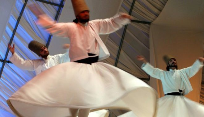Turkish Sema Sufi dancers perform during a traditional music concert commemorating Iranian poet Rumi, also known as Molavi, a 13th century Persian Muslim poet, in Tehran, Iran, Friday, Aug. 31, 2007. (AP Photo/Vahid Salemi)