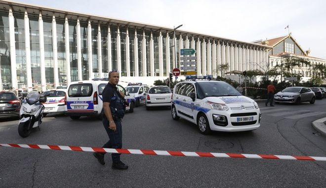 A French police officer cordons off the access to Marseille 's main train station Sunday, Oct. 1, 2017 in Marseille, southern France. French police have warned people to avoid Marseille's main train station following a knife attack that made at least one dead. (AP Photo/Claude Paris)