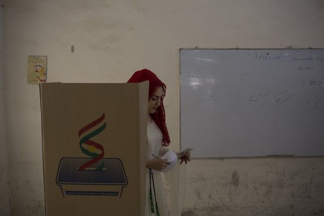 A Kurdish woman leaves the voting booth after voting for Kurdish independence in the city of Kirkuk, Monday Sept. 25, 2017. Iraq's Kurdish region vote in a referendum on whether to secede from Iraq. (AP Photo/Bram Janssen)