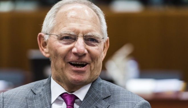 German Finance Minister Wolfgang Schauble arrives for a meeting of EU finance ministers at the EU Council building in Brussels, Tuesday July 11, 2017. (AP Photo/Geert Vanden Wijngaert)
