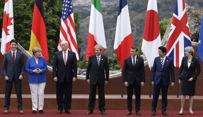 Leaders of the G7, from left, Canadian Prime Minister Justin Trudeau, German Chancellor Angela Merkel, U.S. President Donald Trump, Italian Prime Minister Paolo Gentiloni, French President Emmanuel Macron, Japan's Prime Minister Shinzo Abe, and British Prime Minister Theresa May pose during a group photo for the G7 summit in the Ancient Theatre of Taormina ( 3rd century BC) in the Sicilian citadel of Taormina, Italy, Friday, May 26, 2017. Leaders of the G7 meet Friday and Saturday, including newcomers Emmanuel Macron of France and Theresa May of Britain in an effort to forge a new dynamic after a year of global political turmoil amid a rise in nationalism. (AP Photo/Andrew Medichini)