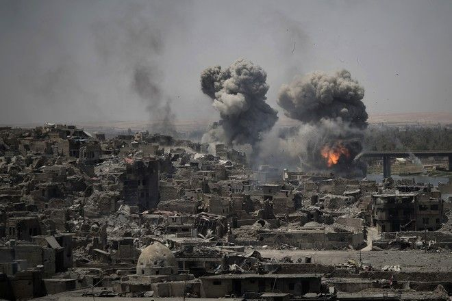2017 AP YEAR END PHOTOS - Airstrikes target Islamic State positions on the edge of the old city of Mosul, Iraq, on July 11, 2017, a day after Iraq's prime minister declared