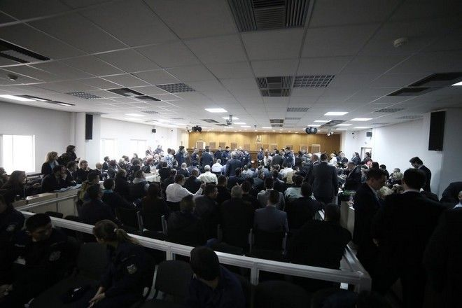 Defendants for trial of the Golden Dawn during the transfer to the special courtroom of the Korydallos prison, Athens on April 20, 2015. /                    ,   20  2015.