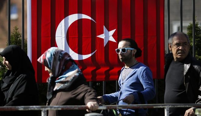 FILE - In this March 27, 2017 file photo people wait outside the Turkish consulate in Berlin, Germany, to cast their votes on the first day of the referendum on the presidential system in Turkey. The high support for Turkeys president of Turks living in the European Union has worried some officials in the 28-nation bloc. Critics fear their endorsement of Turkish President Recep Tayyip Erdogans push toward undisputed rule amounts to a rejection of the Western democracies many Turks have lived in for decades. (AP Photo/Markus Schreiber, file)