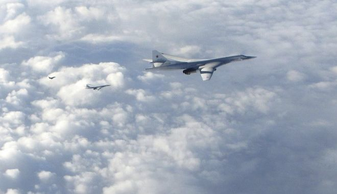 In this image made available by the Royal Air Force Monday, Jan. 15, 2018, two Russian Blackjack Tupolev Tu-160 long-range bombers are followed by an RAF Typhoon aircraft, left, scrambled from RAF Lossiemouth, Scotland. The incident Monday is one of several in recent years as Russian military planes test NATO and British air defenses. (Royal Air Force via AP)