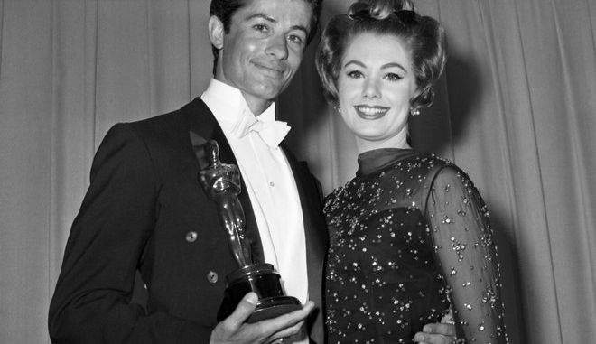 George Chakiris holds his Oscar for Best Supporting Actor in the film West Side Story, at the Academy Awards, in Santa Monica, Ca., on April 9, 1962, with the actress Shirley Jones, who presented him with the award. (AP Photo)