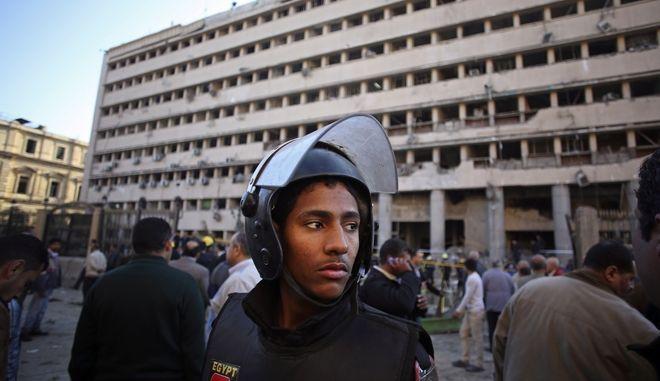 An Egyptian policeman stands guard