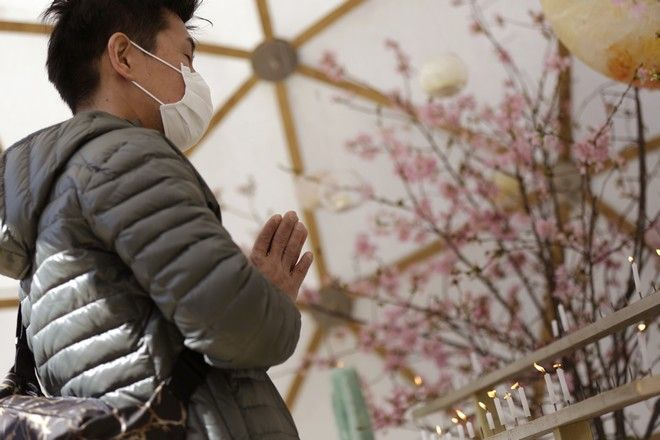 A man prays to mourn for victims of the March 11, 2011 earthquake and tsunami prior to a special memorial event in Tokyo, Saturday, March 11, 2017. Japan on Saturday marked the sixth anniversary of the 2011 disaster that left more than 18,000 people dead or missing and led to a meltdown at the Fukushima Dai-Ichi nuclear plant. (AP Photo/Eugene Hoshiko)