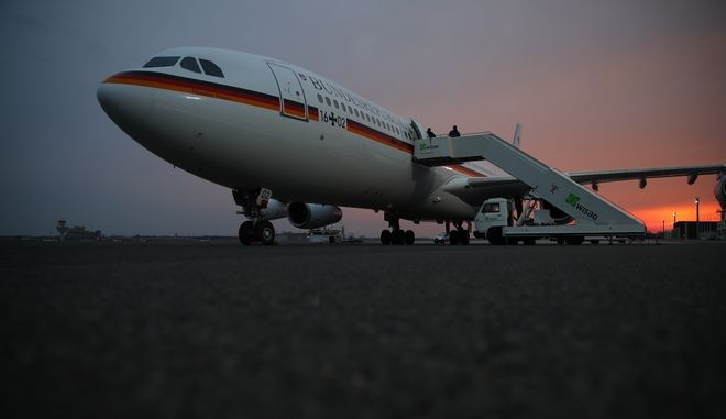 An  Airbus A340 stands at Berlin Tegel airport in Berlin. Monday March 13, 2017. and waits for German chancellor Angela Merkel and her delegation for their flight to the USA to meet with president Donald Trump.   (Michael Kappeler/dpa via AP)