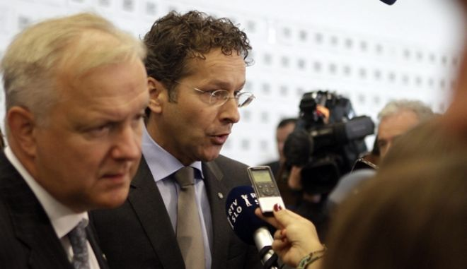 epa03865668 Netherlands Minister of Finance Jeroen Dijsselbloem (R) and Vice President of the European Commission, Commissioner for Economic and Monetary Issues Olli Rehn during an informal meeting of European Union Finance Ministers in Vilnius, Lithuania, 13 September 2013.  EPA/VALDA KALNINA LATVIA OUT/LITHUANIA OUT/ESTONIA OUT