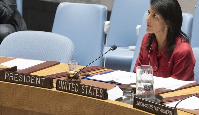 United States' Ambassador United Nations and current Security Council President Nikki Haley listens as Syria's Deputy U.N. Ambassador Mounzer Mounzer speaks during a Security Council meeting on the situation in Syria, Friday, April 7, 2017 at United Nations headquarters. (AP Photo/Mary Altaffer)