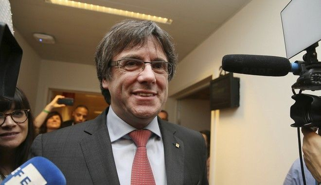 Ousted Catalan leader Carles Puigdemont smiles as he arrives to attend a gathering to watch the election results for Spain's Catalonia region at the Square Meeting Center in Brussels on Thursday, Dec. 21, 2017. Several members of the ousted Cabinet, including Puigdemont, have campaigned from Brussels, where they sought refuge from Spanish justice. (AP Photo)