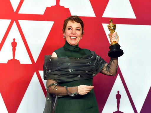Olivia Colman poses with the award for best performance by an actress in a leading role for