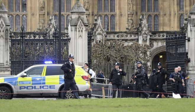 Police on the scene after sounds similar to gunfire have been heard close to the Houses of Parliament, London, Wednesday, March 22, 2017. London police say officers called to 'firearms incident' on Westminster Bridge, near Parliament. (Victoria Jones/PA via AP)