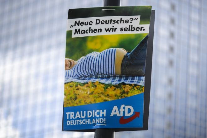 A election campaign poster of the German anti-immigrant party AfD, Alternative for Germany, reading: 'New Germans? - We'll make them ourselves' is displayed in central in Berlin, Germany, Sunday, Aug. 13, 2017. General national election will be held in Germany on Sept. 24, 2017. The sentence at the bottom reads: 'Trust yourself Germany'. (AP Photo/Markus Schreiber)
