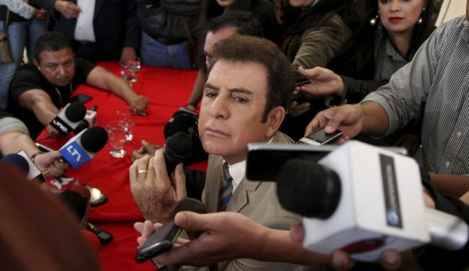 Honduran presidential candidate Salvador Nasralla holds a press conference in Tegucigalpa, Honduras, Friday, Dec. 22, 2017. The Trump administration recognized the results of Honduras' disputed presidential election despite opposition complaints, irregularities found by poll observers and calls from Congress to back a new vote. (AP Photo/Fernando Antonio)