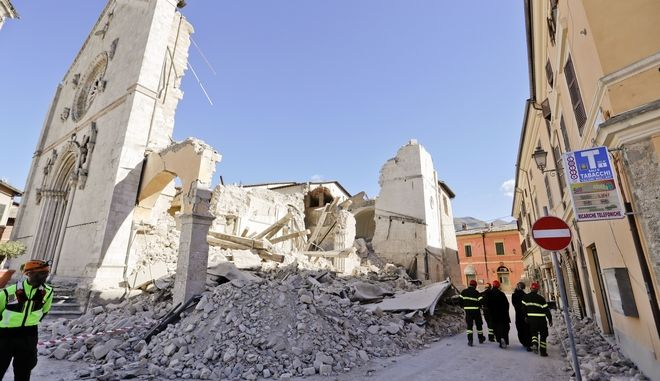 Monks walk in front of the Cathedral of St. Benedict in Norcia, central Italy, Italy, Monday, Oct. 31, 2016. The third powerful earthquake to hit Italy in two months spared human life Sunday but struck at the nation's identity, destroying a Benedictine cathedral, a medieval tower and other beloved landmarks that had survived the earlier jolts across a mountainous region of small historic towns. (AP Photo/Gregorio Borgia)