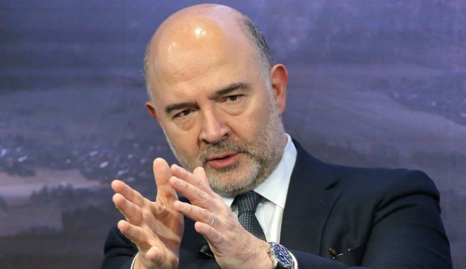 European Commissioner for Economic and Financial Affairs Pierre Moscovici speaks on the second day of the annual meeting of the World Economic Forum in Davos, Switzerland, Tuesday, Jan. 17, 2017. (AP Photo/Michel Euler)