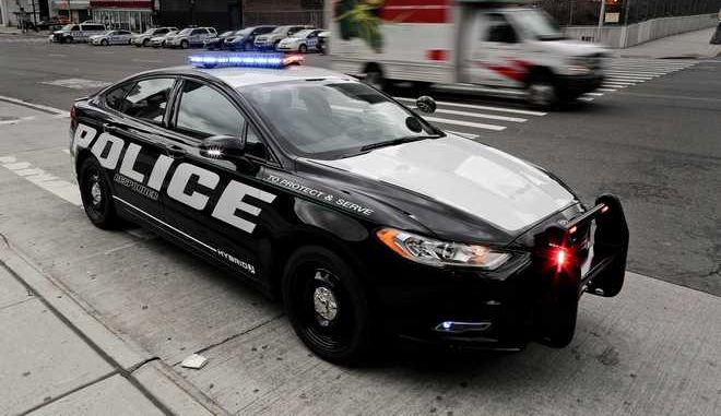 In this Friday, April 7, 2017, photo, a prototype of the Ford Fusion police hybrid car sits along 11th Avenue in New York. Ford Motor Co., which sells more police cars in the U.S. than any other automaker, says it will offer a police pursuit version of the hybrid Fusion midsize sedan, in response to requests from cities nationwide. (AP Photo/Julie Jacobson)