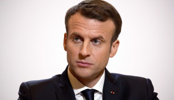 French President Emmanuel Macron listens to a reporter's question at a press conference at the French Embassy in Beijing, Wednesday, Jan. 10, 2018. (AP Photo/Mark Schiefelbein, Pool)