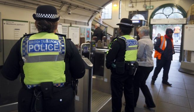 Transport police keep guard at Parsons Green station in London, Monday, Sept. 18, 2017. A bucket wrapped in an insulated bag caught fire on a packed London subway train at Parsons Green station on Friday Sept. 15, police are treating it as a terrorist incident. (AP Photo/Kirsty Wigglesworth)