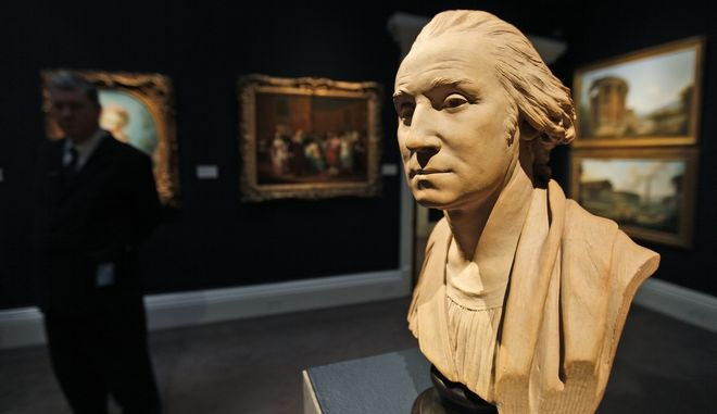 A bust of George Washington, is seen during a photo-op ahead of an auction in Sotheby's auction house in central London, Friday July 3, 2009. People looking for a keepsake to mark America's Independence Day might consider a rare bust of George Washington being auctioned by Sotheby's in London. The bust comes from the workshop of 18th-Century master sculptor Jean-Antoine Houdon of France and will be sold on July 9. It is one of a series of famous busts of Washington produced after Houdon was commissioned by the US Congress and the Virginia Legislature to produce a life-sculpture of Washington. Officials expect the bust to be sold for more than 300,000 pounds (490,000 US dollars). (AP Photo/Lefteris Pitarakis)