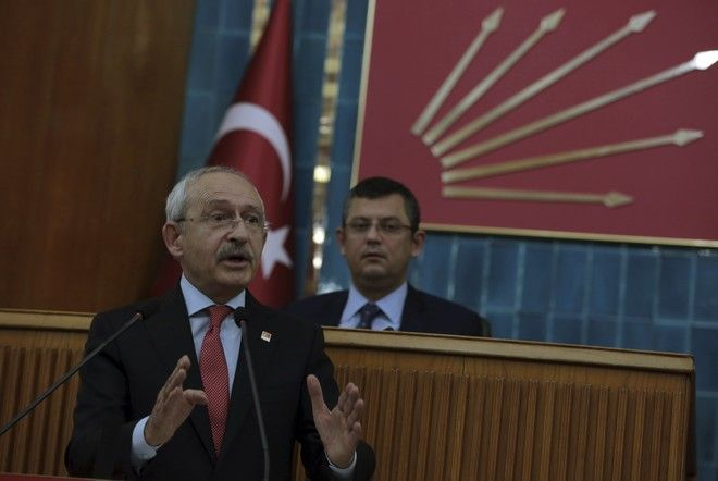 Turkey's main opposition Republican People's Party leader Kemal Kilicdaroglu addresses his lawmakers after Turkey's parliament approved a contentious constitutional reform package, paving the way for a referendum on a presidential system that would greatly expand the powers of President Recep Tayyip Erdogan's office, in Ankara, Turkey, early Saturday, Jan. 21, 2017.  In an all-night session that ended early Saturday, lawmakers voted in favour of a set of amendments presented by the ruling party, founded by Erdogan.(AP Photo/Burhan Ozbilici)