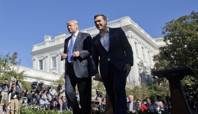 President Donald Trump and Greek Prime Minister Alexis Tsipras walk away from their podiums at the conclusion of a news conference in the Rose Garden of the White House in Washington, Tuesday, Oct. 17, 2017. (AP Photo/Pablo Martinez Monsivais)