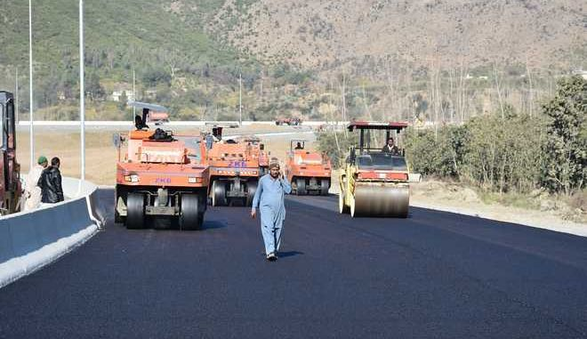 "In this Dec. 22, 2017, photo, work in progress at the site of Pakistan China Silk Road in Haripur, Pakistan. From Pakistan to Tanzania to Hungary, projects under Chinese President Xi Jinping's signature ""Belt and Road Initiative"" are being canceled, renegotiated or delayed due to disputes about costs or complaints host countries get too little out of projects built by Chinese companies and financed by loans from Beijing that must be repaid. (AP Photo/Aqeel Ahmed)"