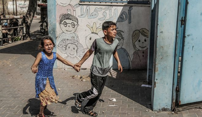 Children run on a street of Gaza city. Of the 2 million Palestinians living in Gaza, over 40 per cent are children aged 14 or under. These children have lived their entire lives under Israeli blockade, survived four major offensives by Israel and experience repetitive and ongoing trauma.