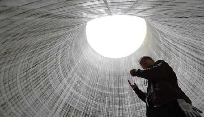 In this April 29, 2015 photo, Tom Wallace, the senior manager for Unit 2, leads a tour inside the Unit 2 cooling tower, which is under construction, at the Watts Bar Nuclear Plant near Spring City, Tenn. When Wallace started working for the Tennessee Valley Authority as a young man in 1979, he hoped he could run its newest nuclear reactor at the Watts Bar power plant. Wallace is still finishing that plant 36 years later, one of the longest building projects in U.S. history. (AP Photo/Mark Zaleski)