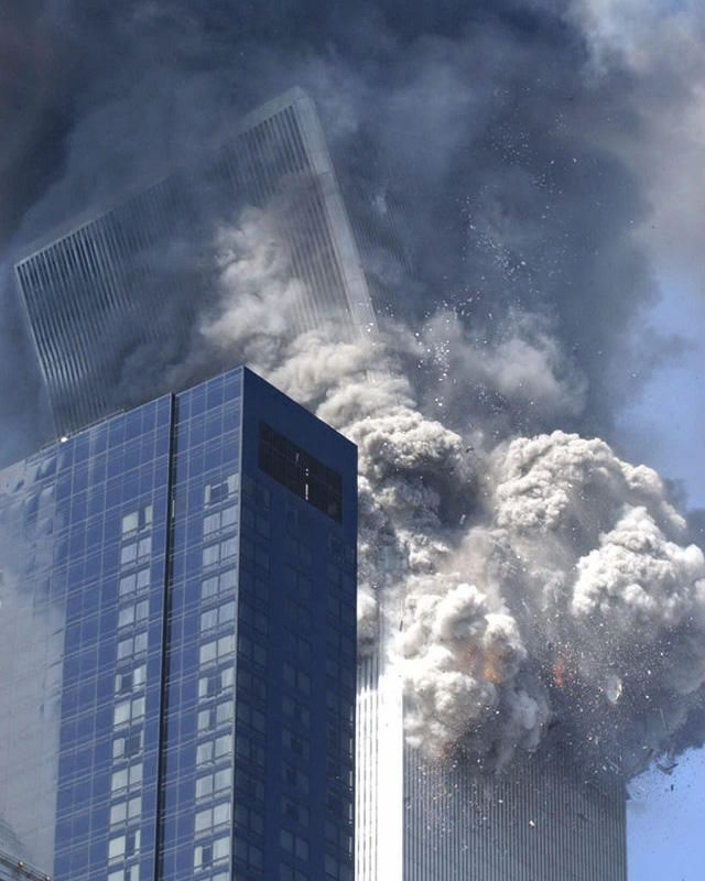 ** FOR USE AS DESIRED WITH SEPT. 11 ANNIVERSARY STORIES--FILE **The south tower of the World Trade Center begins to collapse following a terrorist attack on the New York landmark, in this Sept. 11, 2001, file photo. This year will mark the fifth anniversary of the attacks.  (AP Photo/Amy Sancetta/FILE)   Original Filename: SEPT__11_ANNIVERSARY_NY243.jpg