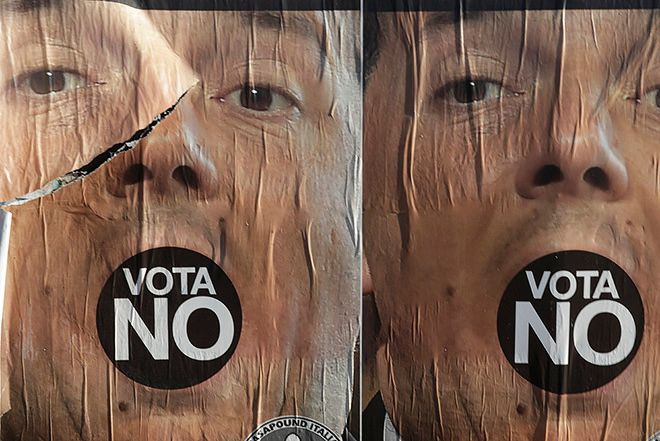 Anti-referendum posters showing Premier Matteo Renzi are seen in Rome a day after the referendum vote, Monday, Dec. 5, 2016. Italian voters dealt Premier Renzi a resounding rebuke early Monday by rejecting his proposed constitutional reforms, plunging Europe's fourth-largest economy into political and economic uncertainty. (AP Photo/Gregorio Borgia)