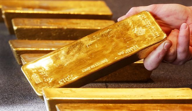 FILE - In this Feb. 9, 2017 file photo  various gold bars are on display at the Bundesbank  headquarter in Frankfurt, Germany. Germanys central bank says its finished bringing home the last of its gold reserves it plans on repatriating, which had been stashed abroad during the Cold War. The Bundesbank said Wednesday. Aug. 23, 2017  that 91 metric tons (100.3 tons) of gold had been returned from Paris. The plan, completed three years ahead of schedule, saw all 374 tons of gold stored in Paris brought to Germany, as well as 300 tons from New York. (AP Photo/Michael Probst.file)