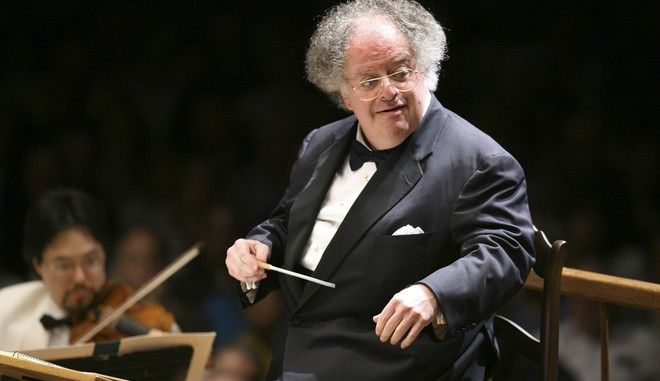 Boston Symphony Orchestra music director James Levine conducts the symphony on its opening night performance at Tanglewood in Lenox., Mass., Friday, July 7, 2006. This was Levine's first appearance since injuring his shoulder in an onstage fall in March. (AP Photo/Michael Dwyer)