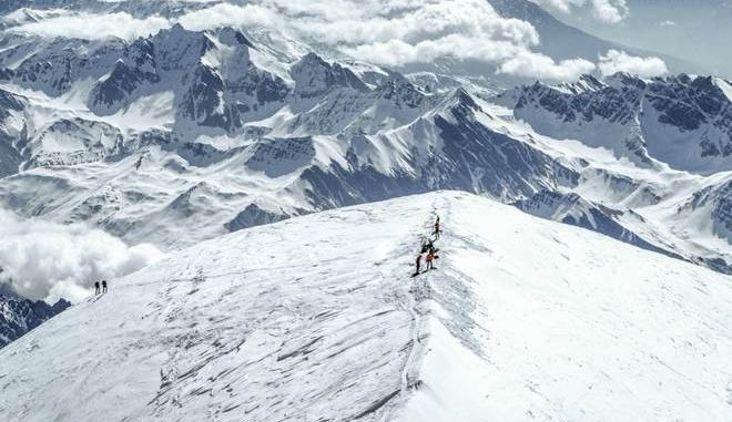 DISTRIBUTED FOR MAMMUT - Mammut athlete Beni Hug, from Switzerland and ski mountaineer Tony Sbalbi, from France, have just completed an awe-inspiring challenge by climbing the highest peaks in their respective native countries in under 50 hours. The route extends along the so-called Haute Route between Chamonix in France and Zermatt in Switzerland which normally takes several days to complete and involves making the entire 140km tour at altitudes of up to 13,902 meters, with a total of 14,622 ascent and descent meters to complete the challenge. Picture shows: The peak of the Mont Blanc and thus the goal of the tour is reached. As Beni Hug is already waiting at 4,810 m, Tony Sbalbi climbs the last meters together with the mountain guide. This record adds to the two endurance specialists May 2015 achievement when they climbed all seven peaks over 4,000 meters in the Swiss region of Aletsch in just 20 hours on touring skis. This was their personal best in that they climbed a total of 7,000 vertical meters and over a distance of about 65 km. (Nicolas Falquet/ PPR for Mammut via AP Images)