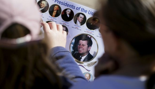 Michelle, right, and Matilda Chipperfield of England look at photos of U.S. Presidents while visiting Dealey Plaza in downtown Dallas, Wednesday, Oct. 25, 2017.  President Donald Trump is caught in a push-pull on new details of President John F. Kennedys assassination, jammed between students of the killing who want every scrap of information and intelligence agencies that are said to be counseling restraint.  How that plays out should be known on Oct. 26, 2017, when long-secret files are expected to be released. (AP Photo/LM Otero)