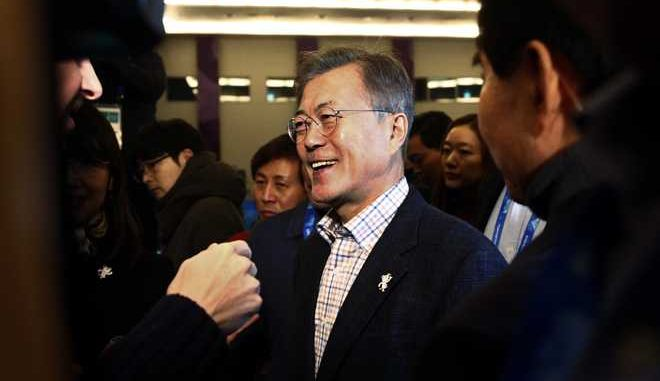 South Korean President Moon Jae-in passes journalists during a visit to the Main Press Center at the 2018 Winter Olympics in Pyeongchang, South Korea, on Saturday, Feb. 17, 2018, (AP Photo/Peter Morgan)