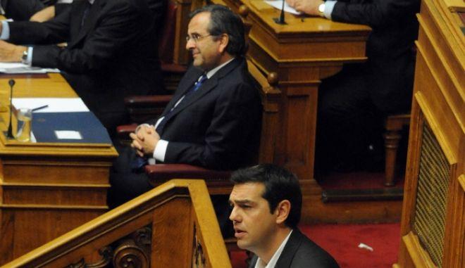 Συνεχίστηκε το απόγευμα της Κυριακής 10 Νοεβρίου 2013, η τριήμερη συζήτηση στη Βουλή επί της πρότασης δυσπιστίας που κατέθεσε ο ΣΥΡΙΖΑ κατά της κυβέρνησης. Στο στιγμιότυπο ο πρόεδρος του ΣΥΡΙΖΑ Αλ. Τσίπρας (EUROKINISSI/ΑΝΤΩΝΗΣ ΝΙΚΟΛΟΠΟΥΛΟΣ)