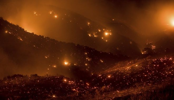 A hillside glows with embers as the Thomas fire burns through Los Padres National Forest near Ojai, Calif., on Friday, Dec. 8, 2017. (AP Photo/Noah Berger)
