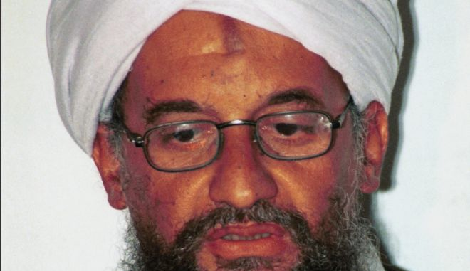 FILE - In this in this 1998 file photo made available Friday, March 19, 2004, Ayman al-Zawahri speaks to the press in Khost, Afghanistan. In a recorded message posted on militant websites late Friday, April 4, 2014, the leader of al-Qaida endorsed a previous call for Islamic arbitration by the al-Qaida-linked Nusra Front over the death of Abu Khaled al-Suri, who it and its allies say was killed by the Islamic State of Iraq and the Levant. (AP Photo/Mazhar Ali Khan, File)
