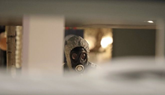 """Investigators inside the Zizzi restaurant in Salisbury, England, Tuesday, March 6, 2018 near to where former Russian double agent Sergei Skripal was found critically ill.  Britain's counterterrorism police took over an investigation Tuesday into the mysterious collapse of a former spy and his daughter, now fighting for their lives. The government pledged a """"robust"""" response if suspicions of Russian state involvement are proven. Sergei Skripal and his daughter are in a critical condition after collapsing in the English city of Salisbury on Sunday. (Steve Parsons/PA via AP)"""