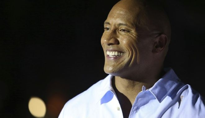 """Dwayne Johnson arrives at the U.S. Premiere of """"Baywatch"""" at Lummus Park on Saturday, May 13, 2017, in Miami Beach, Fla. (Photo by Omar Vega/Invision/AP)"""