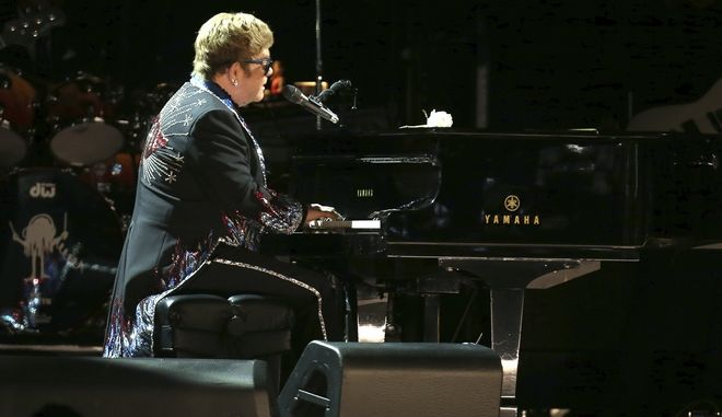 "Elton John performs ""Tiny Dancer"" at the 60th annual Grammy Awards at Madison Square Garden on Sunday, Jan. 28, 2018, in New York. (Photo by Matt Sayles/Invision/AP)"