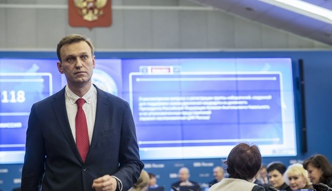Russian opposition leader Alexei Navalny, who submitted endorsement papers necessary for his registration as a presidential candidate, stands at the Russia's Central Election commission in Moscow, Russia, Monday, Dec. 25, 2017. Russian election officials have formally barred Russian opposition leader Alexei Navalny from running for president. (Evgeny Feldman/Navalny Campaign via AP)