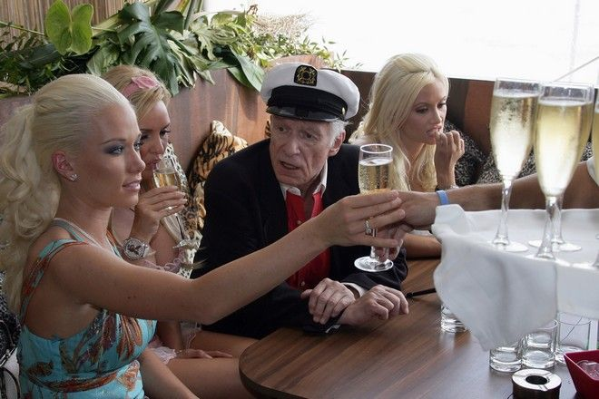 Playboy magazine founder Hugh Hefner, second right, sits with girlfriends Kendra Wilkinson, left, Bridget Marquardt, second left and Holly Madison, right, during a photo call to celebrate his 80th birthday at the 59th International film festival in Cannes, southern France, Thursday, May 25, 2006.  (AP Photo/Francois Mori)